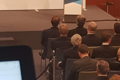 Mrs Merkel, from booth, with partial view of interpreters'